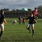 Action from the League Cup game between AFC Norwich and Schoolhouse where the visitors (claret) came