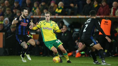 Todd Cantwell of Norwich, Richie Towell of Rotherham United and Zak Vyner of Rotherham United in act