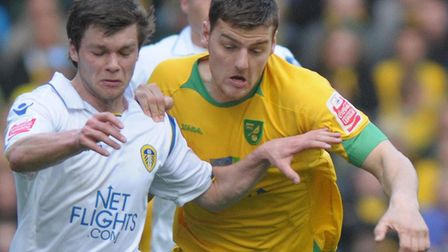 Chris Martin battling with future Norwich midfielder Jonny Howson during City's 1-0 win over Leeds i