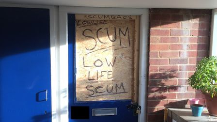 """The words """"lowlife scum"""" scrawled on the door of a flat at Watson Grove, which was raided by police."""