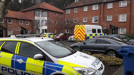 Officers at William Kett Close where eight people were arrested for Class A drug dealing. Picture: S