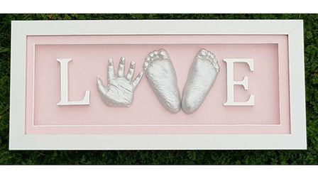 Love sign made with castings from babies hand and feet. Photo: Theresa's Tiny Treasures