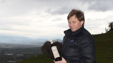 Ian Hutcheon with a bottle of Sacrificio on the way up Mount Tunca, Chile. Picture: Archant Library