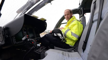 The Duke of Cambridge sits in the cockpit of a helicopter as he begins his job with the East Anglian