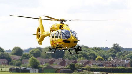 The Duke of Cambridge returns to the new base of East Anglian Air Ambulance at Cambridge Airport ahe