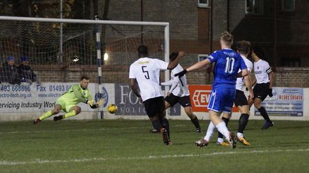 Kieran Higgs gets a shot on goal during Lowestoft Town's clash with Royston at the Amber Dew Events