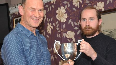 Paul Dennington, left, receives the Charles Grimmer Trophy from Dominic Austrin at the VC Baracchi a