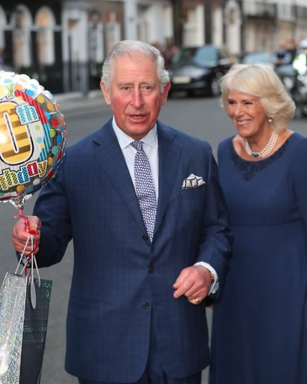 The Prince of Wales and the Duchess of Cornwall arrive for a tea party at Spencer House in London to