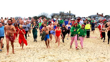 Participants taking part in the Southwold Christmas Day swim in 2017. Picture: CATHY RYAN