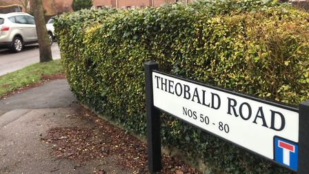 The road sign for Theobald Road, where an aggravated robbery allegedly took place at a residential p