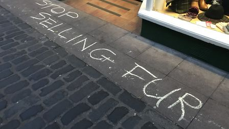 Protesters have chalked 'stop selling fur' outside a Norwich-based country clothing store. Picture: