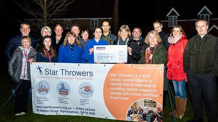 Wood Avens Way, Wymondham, residents handed over a cheque to local cancer charity Star Throwers. Pho