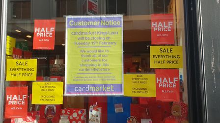 Signs in the window show Card Market will close on February 19. Photo: Emily Prince