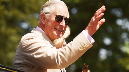 The Prince of Wales waves to the crowd at the end of the tour of the Sandringham Flower Show. Pictur