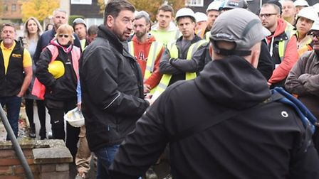 Nick Knowles talks to tradesmen on DIY SOS. Picture: BBC.
