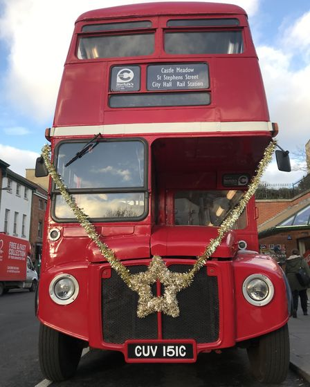 All aboard. A festive Routemaster bus is offering Christmas shoppers a short ride around Norwich wit