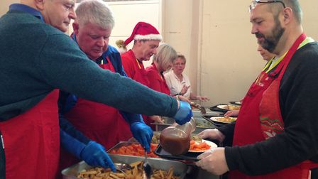 More than 200 volunteers helped to hand out hot meals to guests at the Norwich Open Christmas 2018.