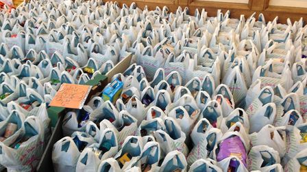 Hundreds of bags of donated food were handed to those in need at the Norwich Open Christmas 2018. Pi