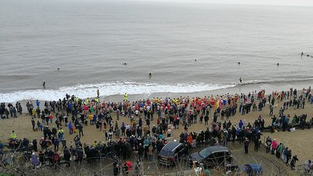 Around 100 people swam in the sea during Mundesley Boxing Day dip 2018. Picture: ELIZABETH HAYNES