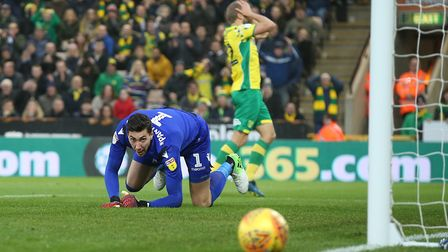 Teemu Pukki sees an effort go wide - to the relief of Costel Pantilimon Picture: Paul Chesterton/Foc