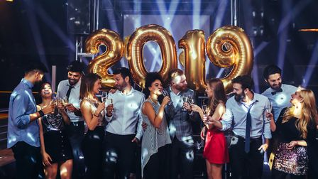 Group of friends celebrating New Year with champagne. Picture: Getty Images/iStockphoto