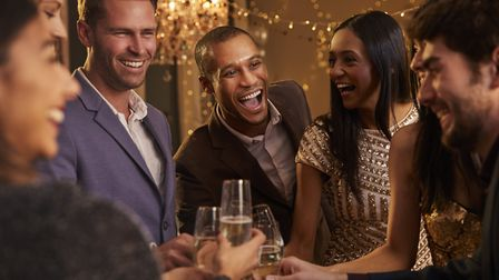 Friends celebrate the New Year at a party. Picture: Getty Images/iStockphoto