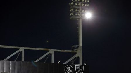 Fans use their phones to light up the ground as floodlight failure hats the match during the Sky Bet