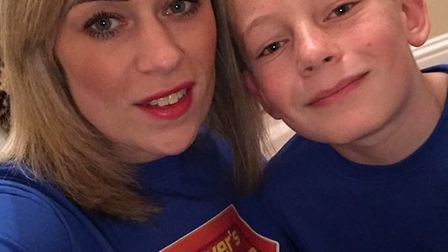 Karly Gray and her son who came up with the idea for a superhero walk in Dereham in support of Denve