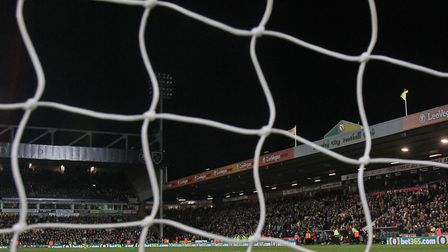 When the lights go out... One corner of Carrow Road is without floodlights after a power surge knock