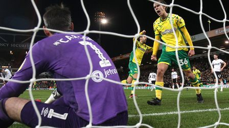 Norwich City celebrate Teemu Pukki's 81st minute strike against Derby - just as the offending floodl