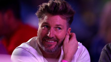 Ex footballer Robbie Savage during day four of the William Hill World Darts Championship at Alexandr