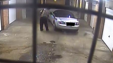 The rough sleeper throws another punch at the side of the victim's car. Photo: Submitted