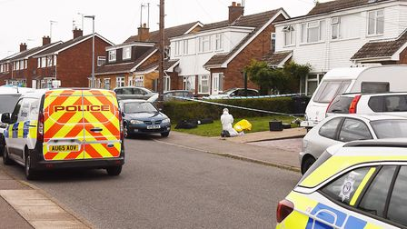 Crime Scene Investigators at the property on Fenland Road in King's Lynn, where a woman was fatally