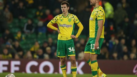 Todd Cantwell of Norwich and Jordan Rhodes of Norwich look dejected after their side concedes its 1s