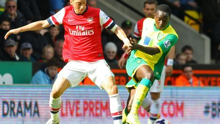 Neil Adams handed Jamar Loza his Norwich debut, pictured here battling with Arsenal and Germany star