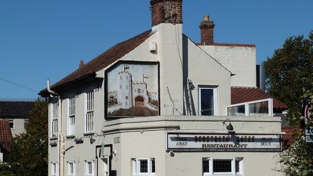 The mural panel on the Berstrete Gates in Norwich which is in desperate need of restoration. Picture