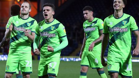 Max Aarons leads the way as the Norwich players celebrate victory at Ewood Park Picture: Paul Cheste