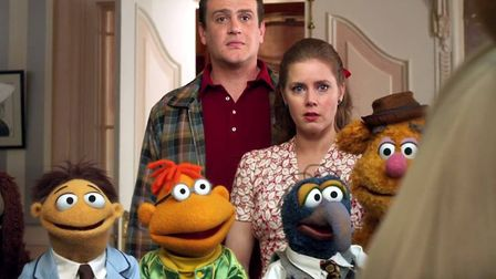Jason Segel and Amy Adams organise a telethon to save The Muppet Theatre in the movie The Muppets Ph