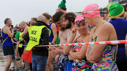 Cromer Boxing Day dip. Swimmers line up at the start line on the beach.Photo: KAREN BETHELL