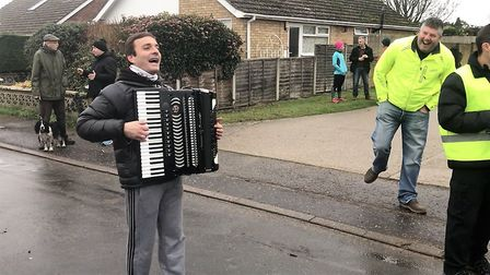 Carmine De Grandis serenading the runners in as they finish Picture: Baz Hipwell
