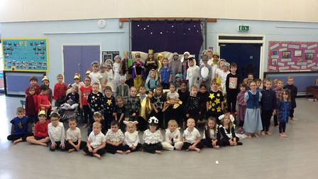 Acle St Edmund Primary School's Reception and Key Stage 1 Nativity cast before they performed 'A Mid