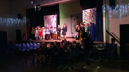 Spooner Row Primary School's Badger and Oak Classes performed Five Gold Rings at Wymondham High Scho