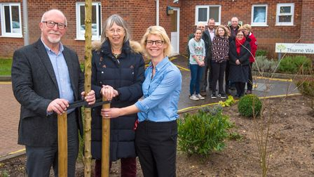 Ann Shreeve, centre pictured with staff and volunteers who came together to transform the outside sp