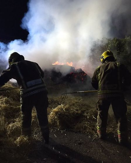 Firefighters from Watton battling a straw bale fire on New Year's Eve in Saham. Picture: Norfolk Fir