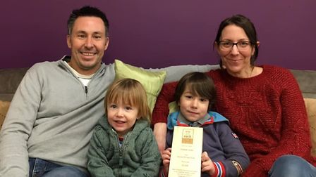 Brad and Debbie McLean with sons Gus, five, and Otis, two, after being presented with a plaque in re