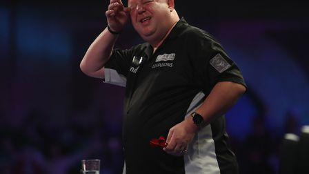 Mervyn King was in second round action in the PDC World Darts Championship last night Picture: Lawre