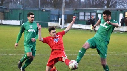 Gorleston's David Shade makes a challenge as high-flying Stowmarket apply some pressure at Emerald P