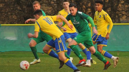 Action from Norwich United against Gorleston. Hadyn Davies, front, for Norwich, and Elliott Hannant