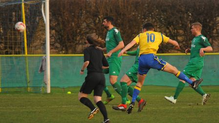 Hadyn Davies (10) tries a shot at goal for Norwich United Picture: DENISE BRADLEY