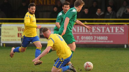 Action from Norwich United against Gorleston. Sam Applegate (4) and George Watts-Sturrock for Norwic
